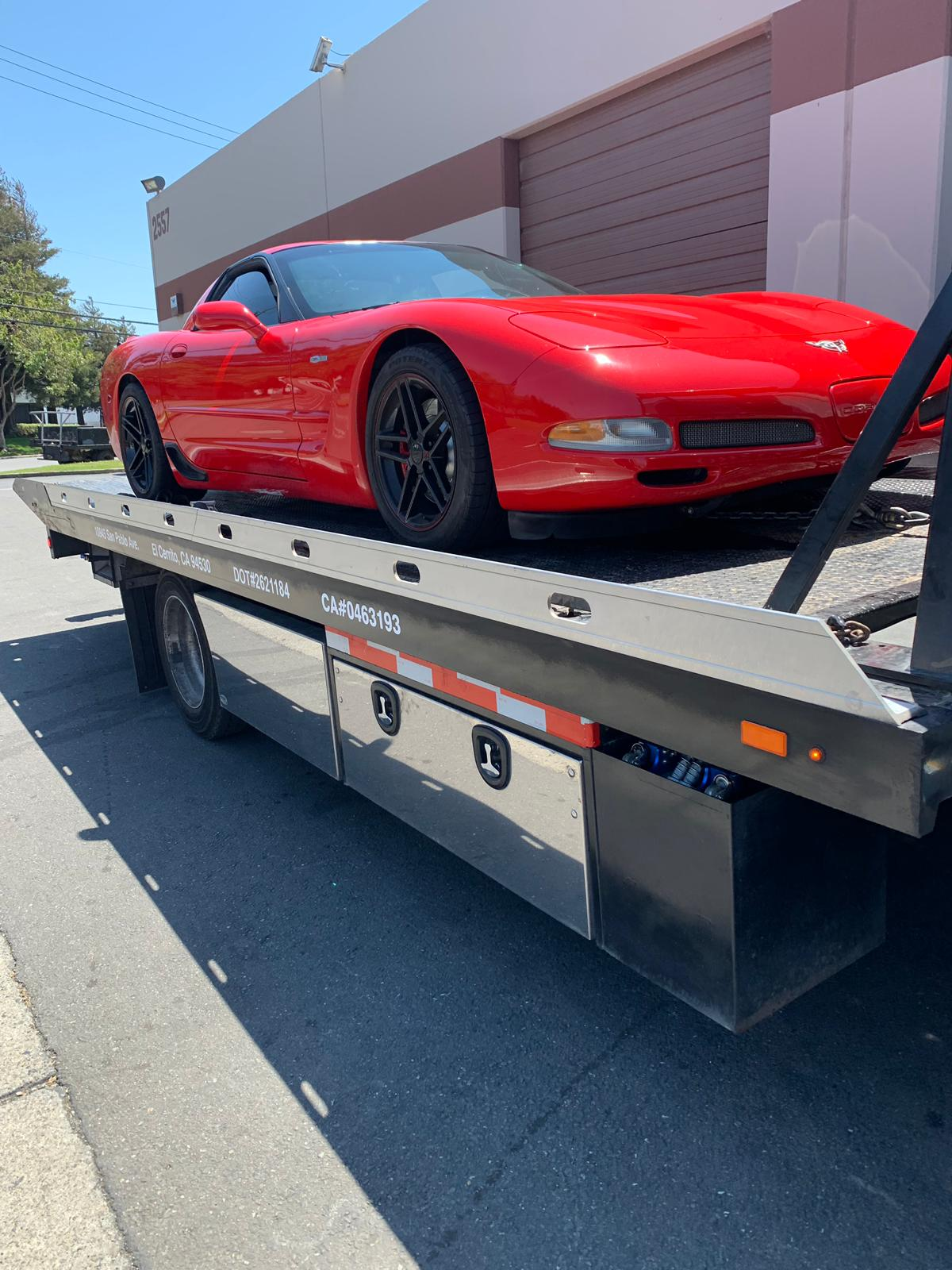 Luxury Red Car Towing